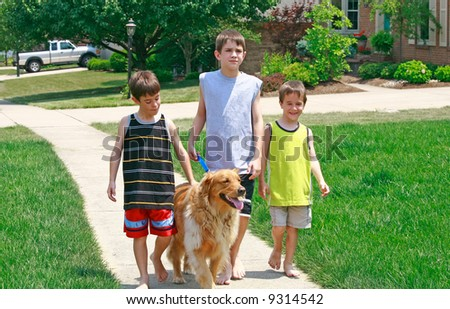Kids Walking the Dog - stock photo