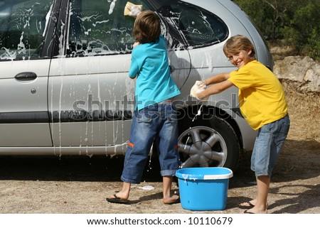 kids washing car - stock photo