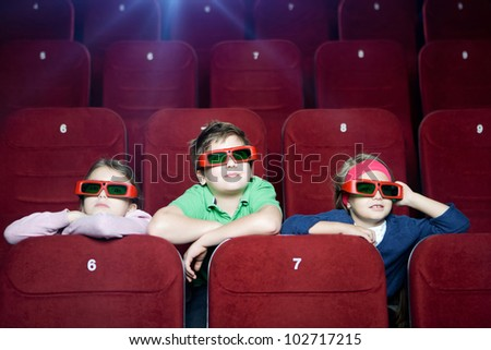 Kids watching 3D cartoon in the movie theater - stock photo