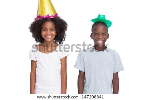 Kids wearing party hats on a white background - stock photo