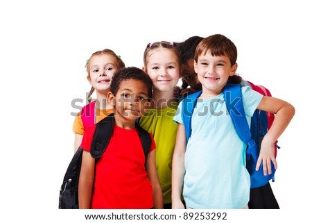 Kids with backpacks in colorful t-shirts - stock photo