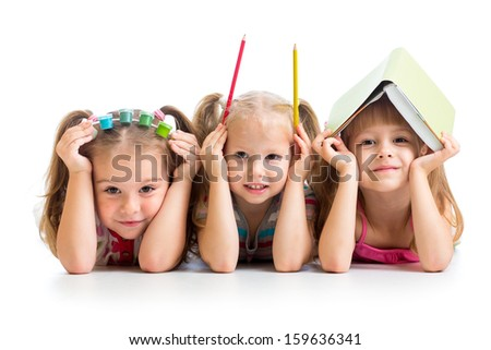 kids with book, pencils and paints on their heads - stock photo