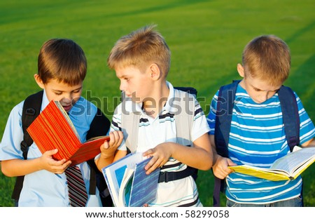 Kids with books  in park - stock photo