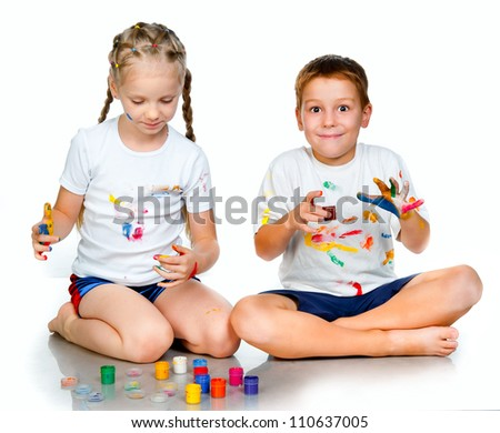 kids with �¢??�¢??hands in paint  on a white background