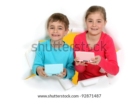 Kids with portable games console - stock photo
