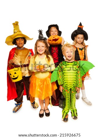 Kids with pumpkin and in Halloween costumes - stock photo