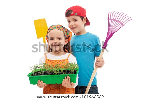 Kids with spring seedlings and gardening tools - isolated - stock photo