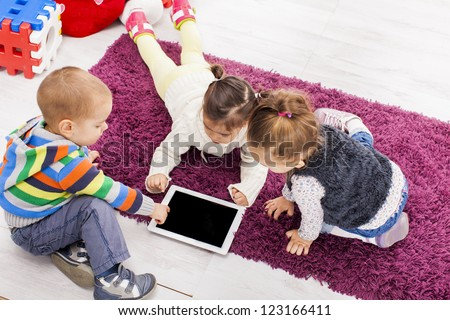 Kids with tablet - stock photo