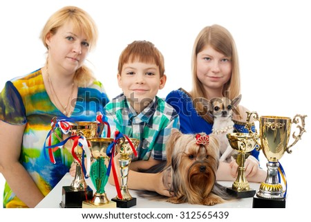 kids with the little dogs and awards - stock photo
