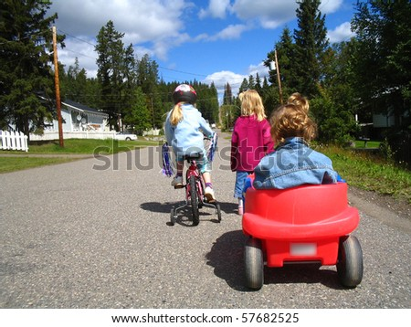 Kids with wagon and bike - stock photo