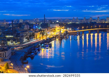 Kiev - Capital of Ukraine. View of the Dnieper River, River station and the historic district of Podil. Night panorama of Kyiv. - stock photo