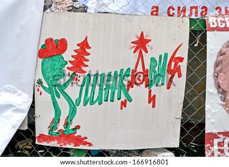 KIEV - DEC 06: Poster with blood tree on ukrainian language on Euro maidan meeting in Kiev on December 06, 2013. Meeting devoted to declining of Ukraine for integration to the European Union. - stock photo