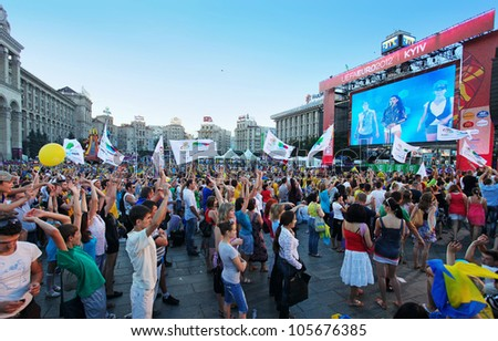 KIEV - JUNE 19: people watching Ruslana's live concert in football fun zone at Maidan Nezalezhnosti on June 19, 2012 in Kiev, UKRAINE. EURO 2012 Football Championship started on June 08, 2012. - stock photo