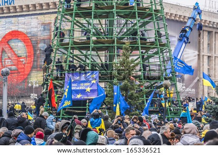 "KIEV (KYIV), UKRAINE - DECEMBER 1, 2013: Christmas tree occupied by protesters in Kiev during the meeting against forceful break up of pro-European ""Euromaidan"" by police on Friday night. - stock photo"