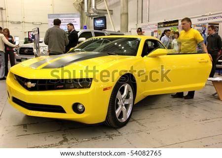 "KIEV - MAY 27: Annual automotive-show ""SIA 2010"". May 27, 2010 in Kiev, Ukraine. Yellow Chevrolet Camaro - stock photo"