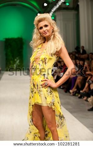KIEV - OCTOBER 17: Paris Hilton as Ukrainian designer Andre Tan model at 29's Ukrainian Fashion Week on October 17, 2011 in Kiev, Ukraine. - stock photo