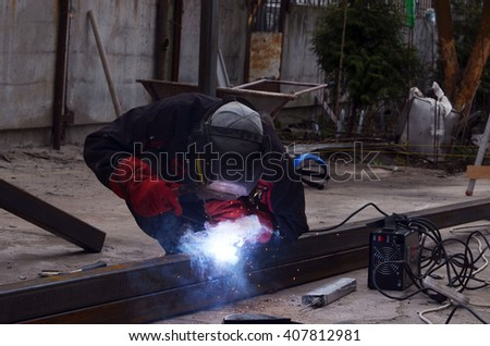 KIEV REGION, UKRAINE - MAR 31, 2016: Worker on the reconstruction old garage in countryside .March 31, 2016 Kiev Region, Ukraine - stock photo