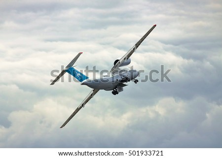 Kiev Region, Ukraine - October 3, 2010: Antonov An-74 cargo plane is taking off and on the banking turn