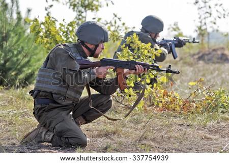 KIEV REGION, UKRAINE - October 02, 2015: Servicemen during a training session at  the Ukrainian National Guard training center,in the village of Stare, Ukraine, 02 October 2015.  - stock photo