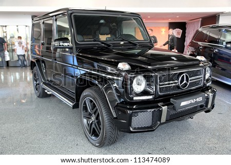 "KIEV - SEPTEMBER 7: Black Mercedes-Benz G 63 AMG at yearly automotive-show ""Capital auto show 2012"". September 7, 2012 in Kiev, Ukraine - stock photo"