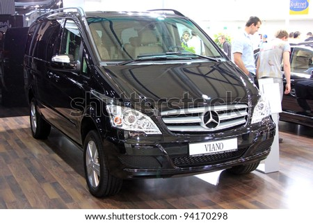 "KIEV - SEPTEMBER 10: Black Mercedes-Benz Viano (V-Class) at yearly automotive-show ""Capital auto show 2011"". September 10, 2011 in Kiev, Ukraine. - stock photo"