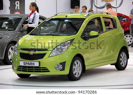 "KIEV - SEPTEMBER 10: Green Chevrolet Spark at yearly automotive-show ""Capital auto show 2011"". September 10, 2011 in Kiev, Ukraine. - stock photo"