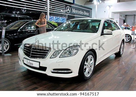 "KIEV - SEPTEMBER 10: Mercedes-Benz E-class at yearly automotive-show ""Capital auto show 2011"". September 10, 2011 in Kiev, Ukraine. - stock photo"