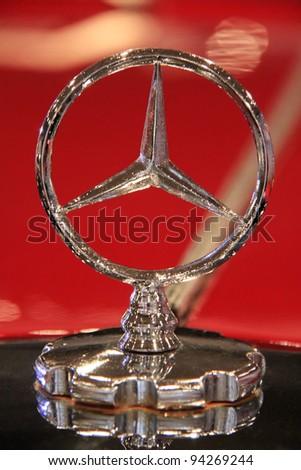 "KIEV - SEPTEMBER 10: Mercedes-Benz emblem at yearly automotive-show ""Capital auto show 2011"". September 10, 2011 in Kiev, Ukraine. - stock photo"