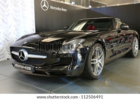 "KIEV - SEPTEMBER 7: Mercedes-Benz SLS AMG at yearly automotive-show ""Capital auto show 2012"". September 7, 2012 in Kiev, Ukraine - stock photo"