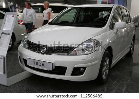 "KIEV - SEPTEMBER 7: Nissan Tiida at yearly automotive-show ""Capital auto show 2012"". September 7, 2012 in Kiev, Ukraine - stock photo"