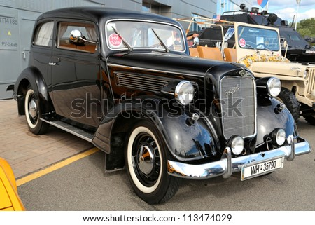 "KIEV - SEPTEMBER 7: Opel Super 6 (1937) at yearly automotive-show ""Capital auto show 2012"". September 7, 2012 in Kiev, Ukraine - stock photo"