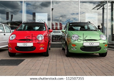 """KIEV - SEPTEMBER 7: Red and green Chery QQ at yearly automotive-show """"Capital auto show 2012"""". September 7, 2012 in Kiev, Ukraine - stock photo"""