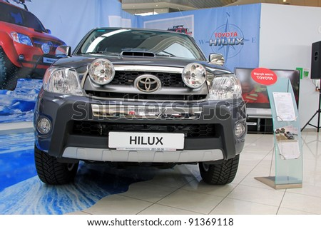 "KIEV - SEPTEMBER 10: Toyota Hilux at yearly automotive-show ""Capital auto show 2011"". September 10, 2011 in Kiev, Ukraine. - stock photo"
