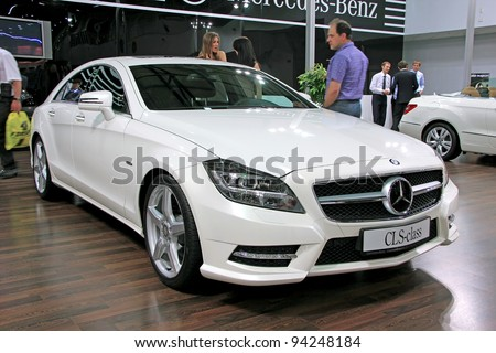 "KIEV - SEPTEMBER 10: White Mercedes-Benz CLS-class (CLS-350) at yearly automotive-show ""Capital auto show 2011"". September 10, 2011 in Kiev, Ukraine."