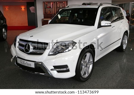 "KIEV - SEPTEMBER 7: White Mercedes-Benz GLK-class at yearly automotive-show ""Capital auto show 2012"". September 7, 2012 in Kiev, Ukraine - stock photo"