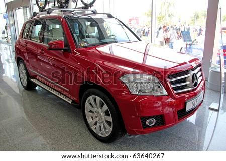 "KIEV - SEPTEMBER 10: Yearly automotive-show ""Capital auto show 2010"". September 10, 2010 in Kiev, Ukraine. Red Mercedes-Benz GLK-class - stock photo"