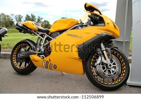 "KIEV - SEPTEMBER 7: Yellow Ducati 999 motorcycle at yearly automotive-show ""Capital auto show 2012"". September 7, 2012 in Kiev, Ukraine - stock photo"