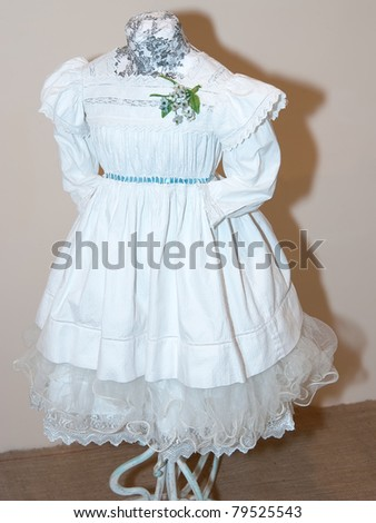 KIEV, UKRAINE - APRIL 16: An original white girl's dress is on display at the Marina Ivanova's private collection exhibit on April 16, 2011 in Kiev, Ukraine.