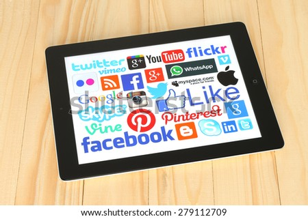 KIEV, UKRAINE - APRIL 30, 2015: Collection of popular social media logos on iPad screen:Facebook, Twitter, Google Plus, Instagram, Skype, WhatsApp, Pinterest, Blogger and others. - stock photo