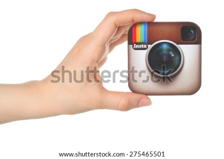 KIEV, UKRAINE - APRIL 30, 2015: Hand holds Instagram logo printed on paper on white background. Instagram is an online mobile photo-sharing, video-sharing service. - stock photo