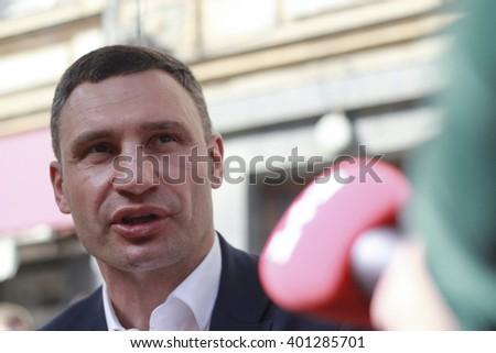 "KIEV, UKRAINE - April 5, 2016: Kyiv Mayor Vitali Klichko took part in the presentation of ""autonomous intelligent mobile stop"" - stock photo"