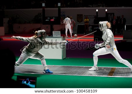 KIEV, UKRAINE - APRIL 13: Team tournament final match of the 2012 Women world fencing on April 13, 2012 in Kiev, Ukraine. - stock photo