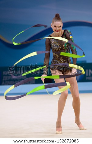 KIEV, UKRAINE - AUGUST 29: Alina Maksymenko of Ukraine in action during the 32nd Rhythmic Gymnastics World Championships in Kiev, Ukraine on August 29, 2013 - stock photo