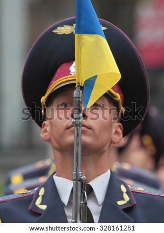 KIEV, UKRAINE - August 23, 2013: Day of Ukrainian flag.A ukrainian soldier during the celebration.