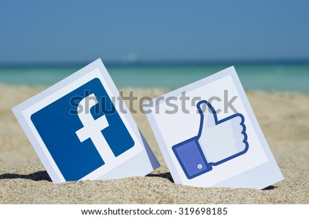 KIEV, UKRAINE - AUGUST 10, 2015: Facebook like logos for e-business, web sites, mobile applications, banners, printed on paper and placed in the sand against the sea Social network facebook sign. - stock photo