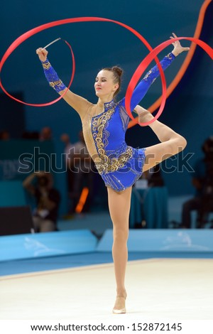 KIEV, UKRAINE - AUGUST 29: Ganna Rizatdinova of Ukraine in action during the 32nd Rhythmic Gymnastics World Championships in Kiev, Ukraine on August 29, 2013 - stock photo