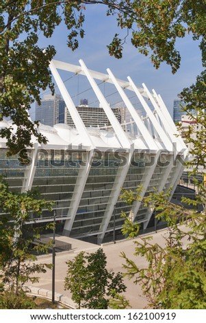 KIEV, UKRAINE - AUGUST 07: Modern Olympic National Sports Complex architecture view from park and East gate on August 07, 2013 in Kiev, Ukraine. It hosted the final of Euro 2012 Football Championship. - stock photo