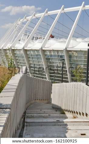 KIEV, UKRAINE - AUGUST 07: Passage to the modern Olympic National Sports Complex, view from East gate on August 07, 2013 in Kiev, Ukraine. It hosted the final of UEFA Euro 2012 Football Championship. - stock photo