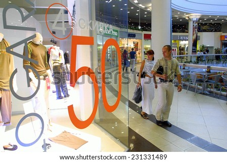 KIEV, UKRAINE, AUGUST 16, 2003: Shoppers hunt for bargains at an upscale mall in Kiev, Ukraine.  - stock photo