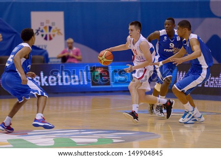 KIEV, UKRAINE - AUGUST 8: Slobodan Jovanovic of Serbia in action during the U16 Eurobasket  2013 First round match between France and Serbia at Palace of Sport in Kiev, Ukraine on August 8, 2013